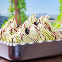 Pure Pistachio Gelato with Cherry Topping Image